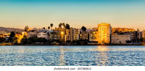 Oakland, California Lake Merritt waterfront buildings at sunset