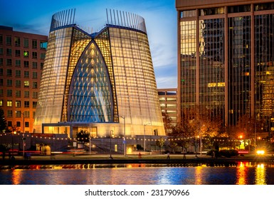 OAKLAND, CALIFORNIA - NOV 10, 2013: Dramatic contemporary glass cathedral illuminated at night on Lake Merritt in downtown Oakland. The award-winning architectural landmark was built in 2008.