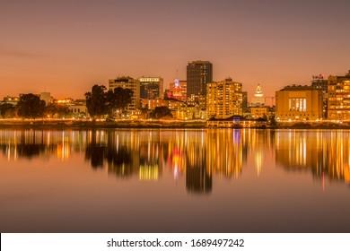 Oakland, California / United States of America - 3/29/20: Oakland Skyline from Lake Merritt