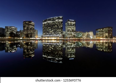 Oakland skyline panorama with Lake Merritt reflections at blue hour. Oakland, Alameda County, California, USA.