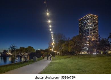 OAKLAND USA - Jan. 7, 2017: Adams Point with Board Walk on Lake Merritt in Oakland at Night.