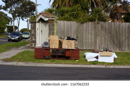 Oakleigh, VIC / Australia - Aug 27 2018: cabinet and miscellaneous hard rubbish put on curbside for council annual collection