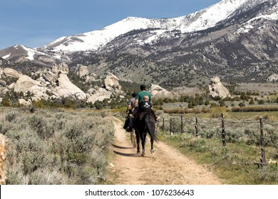 Oakley Idaho, USA May 3. 2014 A family riding horses into the granite formations and the backcountry at the City of Rocks National Reserve near Oakley, Idaho.