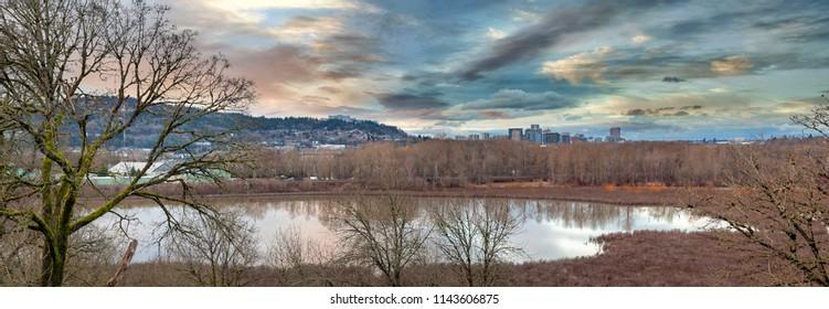 Oaks Bottom Wildlife Refuge with city of Portland Oregon skyline at sunset panorama