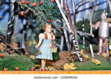 Oaks, PA/USA-March 2, 2019:  Beautiful miniature display of the Wizard of Oz with tiny figurines of Dorothy, Toto and the Tin Man against an apple tree backdrop.  Displayed in American Treasure Museum