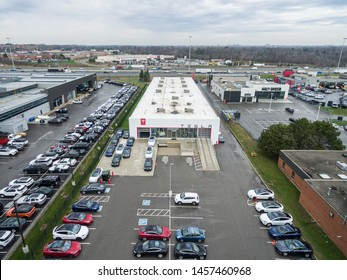 OAKVILLE, CANADA - April 23, 2019: Aerial view of Tesla Service/Delivery Centre - Oakville, ON on wet, cloudy day.