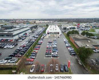OAKVILLE, CANADA - April 23, 2019: Aerial view of Tesla Service/Delivery Centre and full parking lot in Oakville, Ontario.