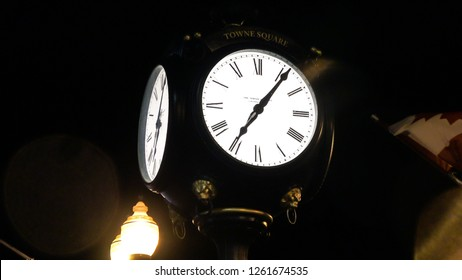 OAKVILLE CANADA - DEC 1 2018: Big and bright clock at town square in downtown Oakville at night