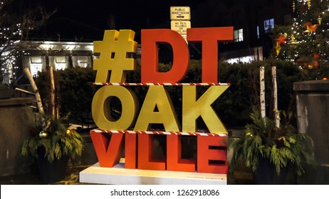 OAKVILLE CANADA - DEC 1 2018: Big DT Oakville sign at night in downtown Oakville