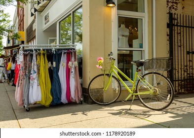 Oakville - Onario - Canada, June 7, 2018: Spring Street Sales occupying the sidewalks of Oakville downtown.