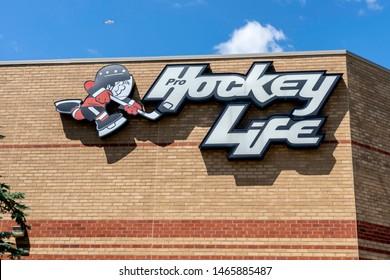 Oakville, Ontario, Canada - July 14, 2019: Hockey Life store sign in Oakville, Ontario, Canada near Toronto, a Canada's hockey megastore owned by Canadian Tire providing the hockey equipment
