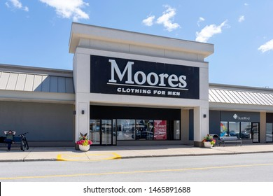 Oakville, Ontario, Canada - July 14, 2019: Moores storefront in Oakville, Ontario, Canada near Toronto. Moores is a Canadian company specializing in business clothing and formalwear for men.