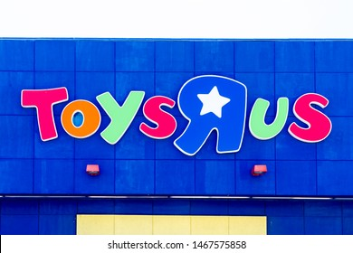 """Oakville, Ontario, Canada - July 14, 2019: Toys """"R"""" Us sign in Oakville near Toronto, Ontario, Canada.  Toys """"R"""" Us, Inc. is an American toy and juvenile-products retailer founded in 1948."""