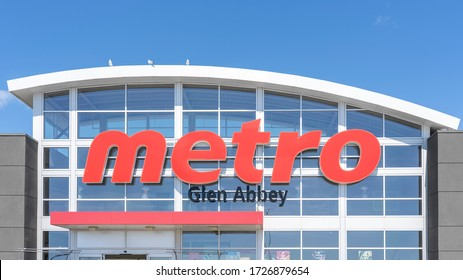 Oakville, Ontario, Canada - July 14, 2019: A Metro store sign in Oakville, Ontario, Canada. Metro Inc. is a Canadian food retailer operating in the provinces of Quebec and Ontario Canada.