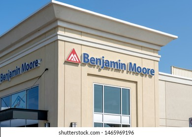 Oakville, Ontario, Canada - July 25, 2019: Benjamin Moore storefront in Oakville, Ontario, Canada.  Benjamin Moore is an American company that produces paint.