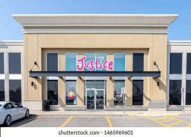 Oakville, Ontario, Canada - July 25, 2019: Justice storefront in Oakville, Ontario, Canada near Toronto. Justice operated by American company Tween Brands, Inc.  sells products for girls age 5–15.
