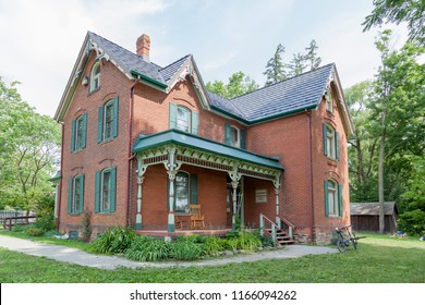 Oakville, Ontario, Canada- July 26, 2018: Spruce Lane Farmhouse in Bronte Creek Provincial Park in Oakville, Ontario.  Built in 1899, the Spruce Lane Farmhouse is a historic house museum