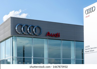 Oakville, Ontario, Canada - July 28, 2019: Sign of  Audi at dealership in Oakville near Toronto, Ontario, Canada.  Audi AG is a German automobile manufacturer for luxury vehicles.