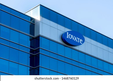 Oakville, Ontario, Canada - July 28, 2019: Sign of Iovate on its head office in Oakville, Ontario, Canada. Iovate Health Sciences International is a Canadian company offers nutritional supplements
