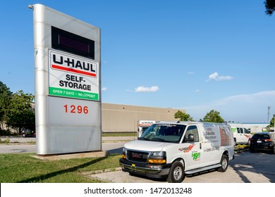 Oakville, Ontario, Canada - July 28, 2019: Sign of U-Haul Moving & Storage of West Oakville, Ontario, Canada. U-Haul is an American moving equipment and storage rental company.