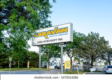 Oakville, Ontario, Canada - July 28, 2019: Sign of Caravan Group of Companies in Oakville, Ontario, Canada, one of Canada's premiere, privately owned, cross border transportation carriers.