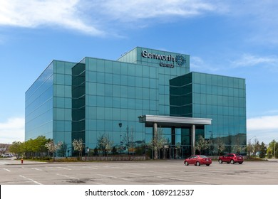 Oakville, Ontario, Canada- May 12th, 2018: Sign of Genworth Canada on the head office building in Oakville, Ontario, the largest private residential mortgage insurer in Canada.