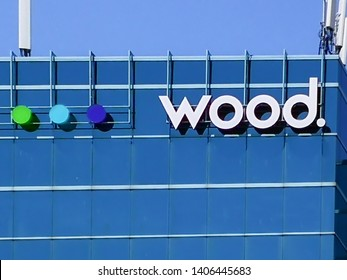 Oakville, Ontario, Canada - May 20, 2019: Sign of Wood on the building in Oakville, Ontario. Wood is a company providing project, engineering and technical services to energy and industrial markets.