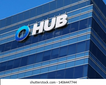 Oakville, Ontario, Canada - May 20, 2019: Sign of HUB International on the building in Oakville, Ontario, Canada. HUB International Limited is an insurance brokerage based in Chicago, USA.