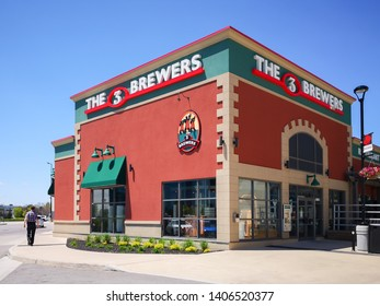 Oakville, Ontario, Canada - May 20, 2019: Sign of 3 Brewers restaurant in Oakville, Ontario, microbrewery dishing out European plates such as German sausages, lamb shanks & flatbreads.