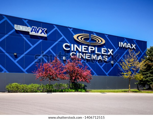 Oakville, Ontario, Canada - May 20, 2019: Sign of Cineplex Cinemas in Oakville, Ontario, Canada.  Cineplex Cinemas operated by Cineplex Inc. a Canadian entertainment company.