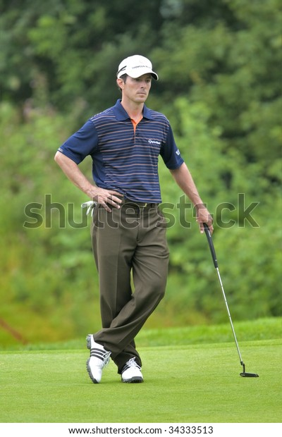 OAKVILLE, ONTARIO - JULY 22: Canadian golfer Mike Weir lines up a putt during a pro-am event at the Canadian Open golf on July 22, 2009.