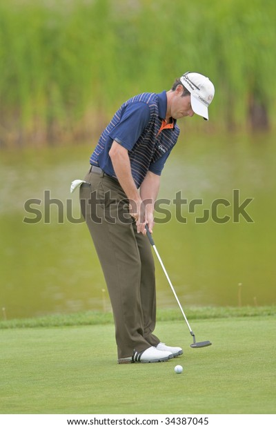 OAKVILLE, ONTARIO - JULY 22: Canadian golfer Mike Weir putts during a pro-am event at the Canadian Open golf on July 22, 2009 in Oakville, Ontario..
