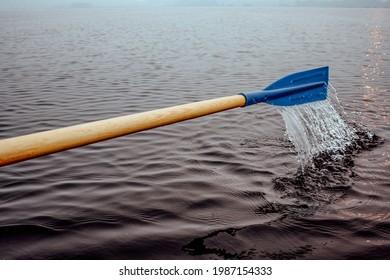 Oar, paddle splashing in the lake, splashing water. High quality photo
