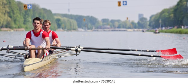 Oarsmen building up speed during a rowing race