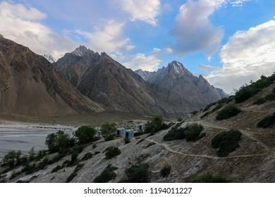 Oasis of green trees on the way to K2 base camp, Trekking along in the Karakorum Mountains in Northern Pakistan, Askole village, Pakistan.
