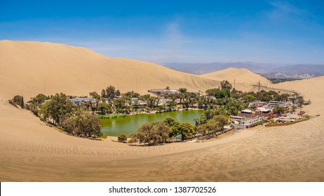 Oasis of Huacachina near Ica city in Peru. Lake and trees inside the dunes