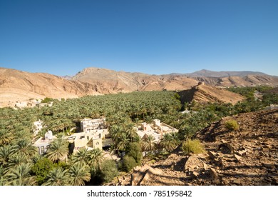 Oasis Panorama Omani Mountains at Jabal Akhdar in Al Hajar Mountains, Oman at sunset. This place is 2000 meters above sea level.