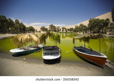 Oasis surrounded by sand dunes near Ica Peru