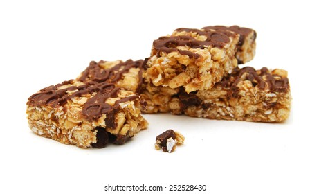 Oat bars with chocolate on white background