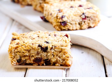 Oat bars with cranberry, nuts and seeds