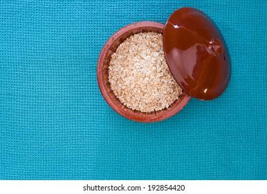oat in a brown ceramic bowl