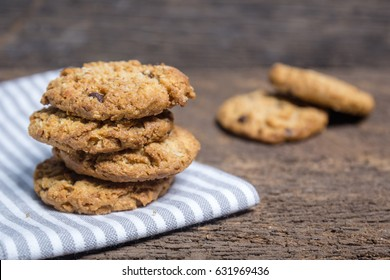 oat and Chocolate chip cookies on rustic wooden table background