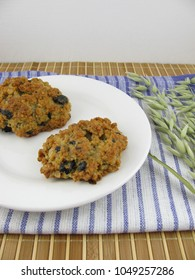 Oat cookies with carob chocolate on a plate