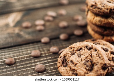 Oat cookies with chokolate drops on brown wooden background
