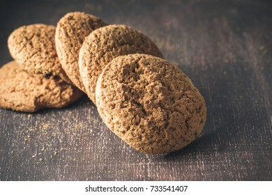 Oat cookies on brown rustic wooden background with space for your text