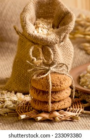 Oat flakes in the bag, oat cookies and spikelets on sackcloth