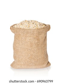 oat flakes in bag from sacking isolated on white background