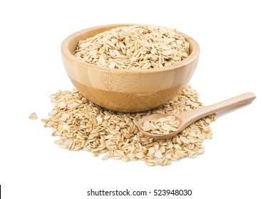 Oat flakes in bowl and wooden spoon isolated on white background.with clipping path