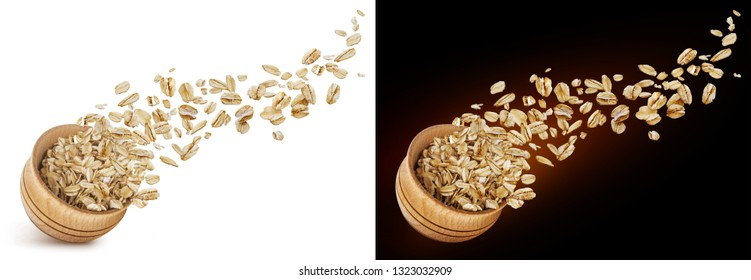 Oat flakes flying out of wooden bowl isolated on white and black background. Falling oats