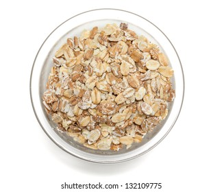 oat flakes in a glass bowl isolated on white backrgound